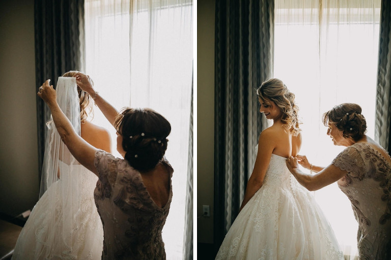 Bride and Mother of the Bride Getting Ready Photo, Back of Strapless David's Bridal Wedding Dress with Lace Overlay and Veil, Mother of Bride with Side Updo with Rhinestone Hair Accessory | Tampa Bay Wedding Courtyard by Marriott St. Petersburg Downtown