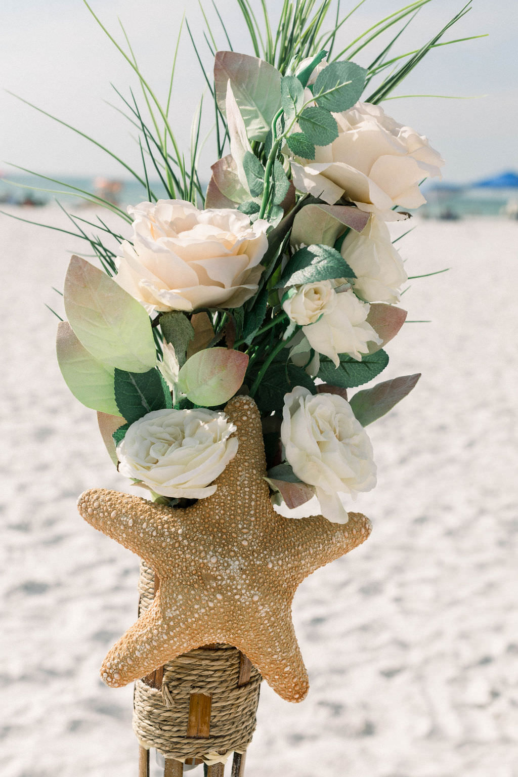 Rustic Beach Elegant Wedding Ceremony Decor, Blush and White Ivory Roses, Greenery Leaves, and Starfish | Clearwater Beach Wedding Planner Gulf Beach Weddings