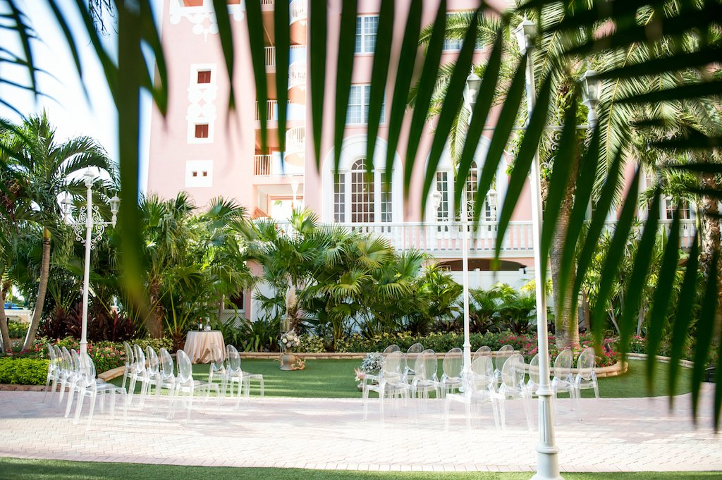 Chic Neutral Tone Modern Outdoor Ceremony with Ghost Acrylic Chairs | | St. Pete Beach Resort Wedding Venue The Don Cesar | Tampa Bay Wedding Photographer Andi Diamond Photography| Tampa Wedding Rentals A Chair Affair | Tampa Bay Wedding Planner UNIQUE Weddings + Events