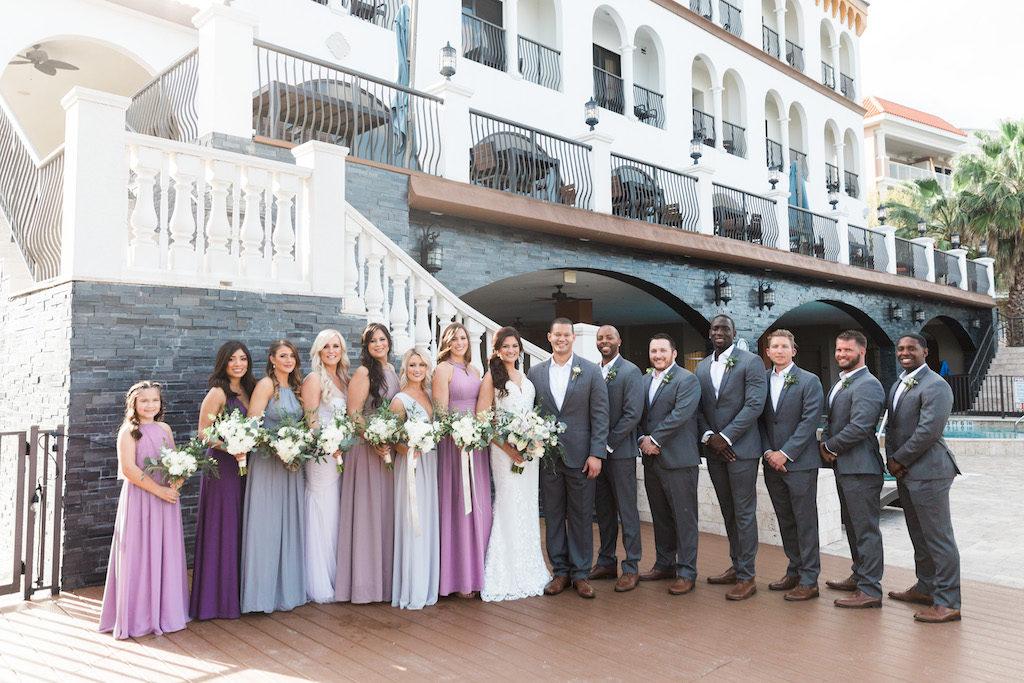 Tampa Bay Bride, Groom, Bridesmaids and Groomsmen Wedding Party Outdoor Portrait, Bridesmaids in Mismatched Lavender, Lilac, Grey, Purple, Grey Long Dresses, Groomsmen in Grey Suits | St. Pete Beach Wedding Venue Hotel Zamora