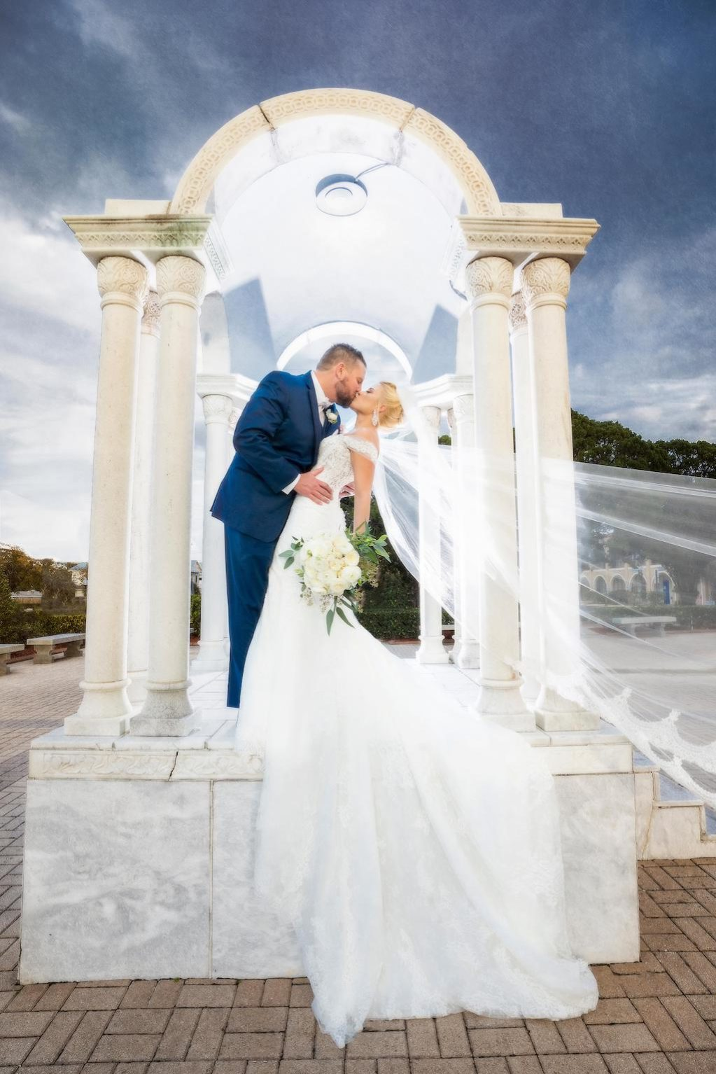 Tampa Bride and Groom Intimate Wedding Portrait, Bride Wearing Pronovias White Lace Wedding Dress With Cathedral Length Train and Veil | Tampa Bay Bridal Dress Shop Nikki and Glitz Glam Boutique