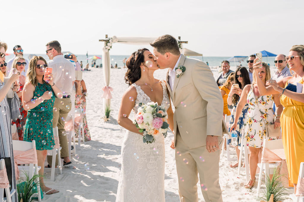 Clearwater Beach Bride and Groom Kiss During Wedding Ceremony Exit | Planner Gulf Beach Weddings