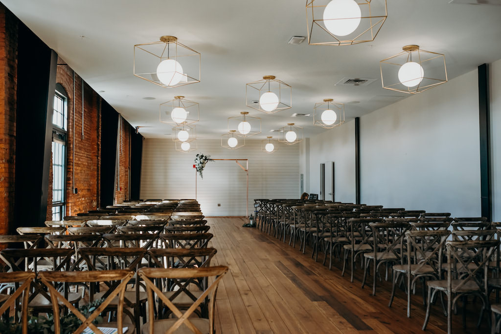 Modern, Geometric Inspired Wedding Ceremony Decor, Wooden Cross-back Chairs, Clean Gold Lighting Design, Simple Arch   Tampa Bay Venue The Gathering at Armature Works