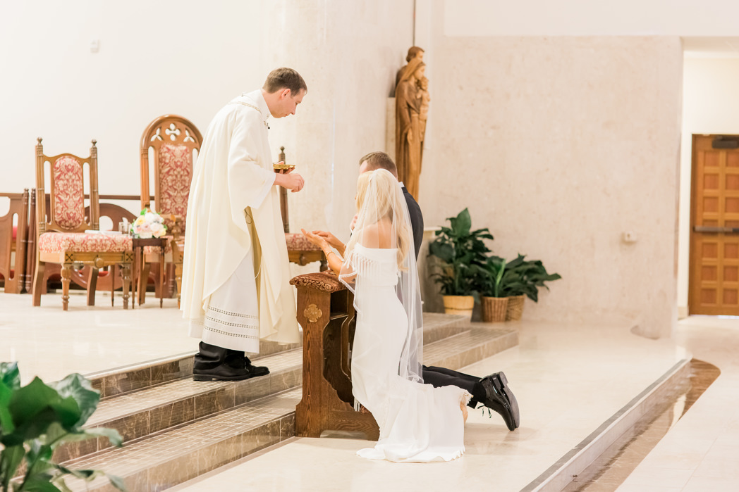 Traditional Bride and Groom Exchanging Vows During Wedding Ceremony | Tampa Bay Wedding Ceremony Venue Christ the King Catholic Church