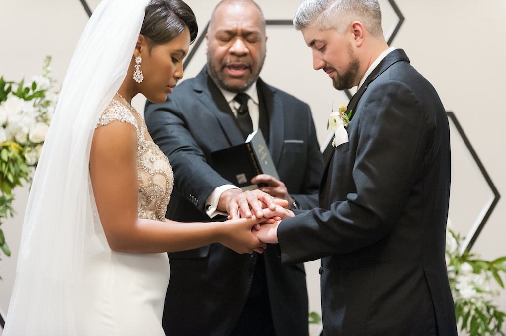 Florida Bride and Groom Hold Hands During Wedding Ceremony   Tampa Bay Wedding Photographer Andi Diamond Photography