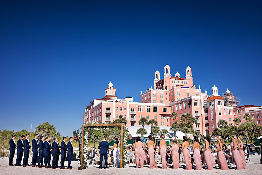 Florida Bride and Groom During Oceanfront Ceremony on White Sand Beach, Romantic Garden Inspired Floral Square Wedding Arch   Tampa Bay Wedding Planner Parties A La Carte   St. Pete Beach Venue The Historic Don Cesar Hotel