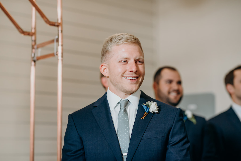 Tampa Bay Groom First Look at His Bride Walking Down the Ceremony Aisle Portrait   Florida Wedding Venue Armature Works