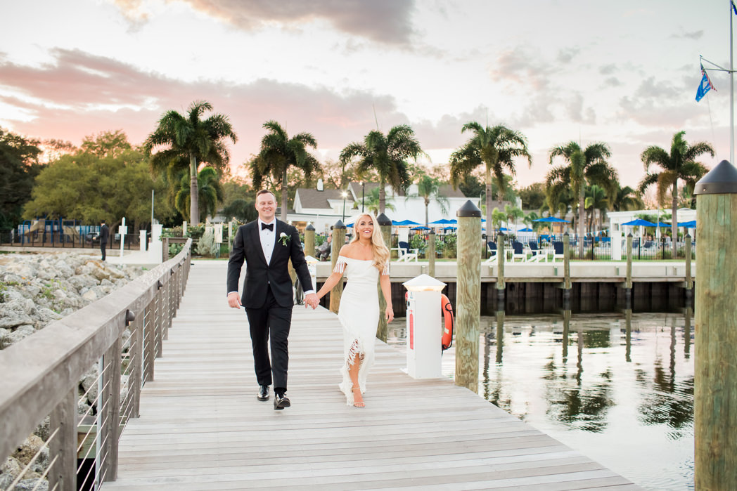 Tampa Bay Florida Bride and Groom on Waterfront Boat Dock During Sunset | Wedding Venue Tampa Yacht and Country Club