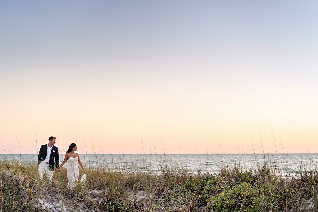 Florida Bride and Groom Wedding Portrait on Sand of St. Pete Beach Historic Don Cesar Hotel