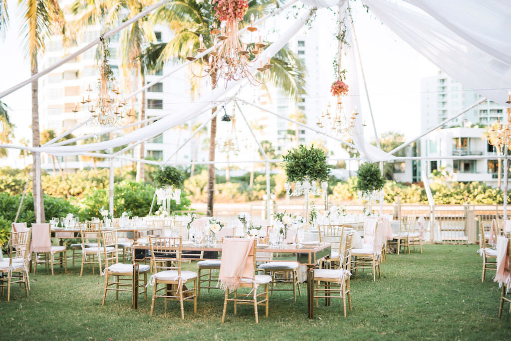 Elegant, Classic, Outdoor Tented Garden Inspired Wedding Decor and Reception, White Pipe and Drape, Feasting Tables with Gold Chiavari Chairs, Tall Green Floral Centerpiece, Gold Chandeliers Hanging Outside, The Ritz Carlton Sarasota | Tampa Bay Wedding Planner NK Weddings
