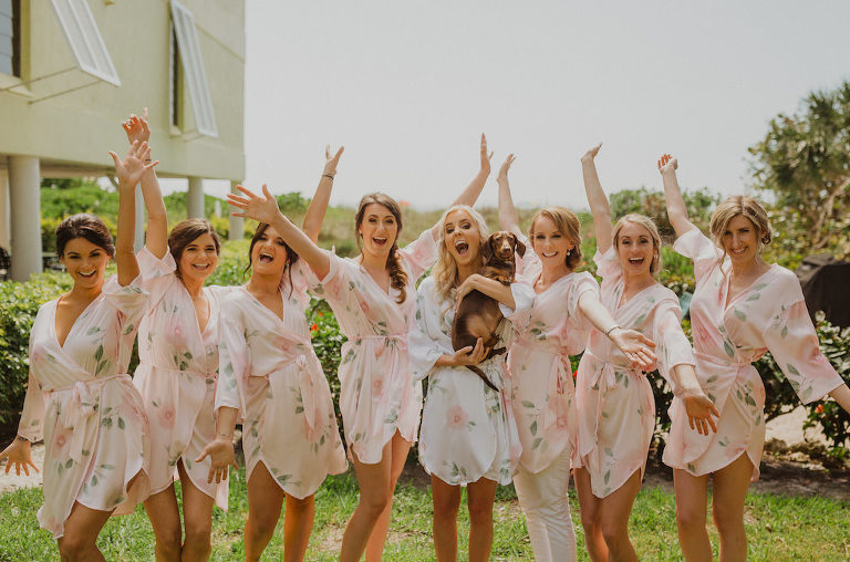 Florida Bride and Dog, Bridesmaids Getting Ready Photo in Matching Blush Pink Floral Silk Robes