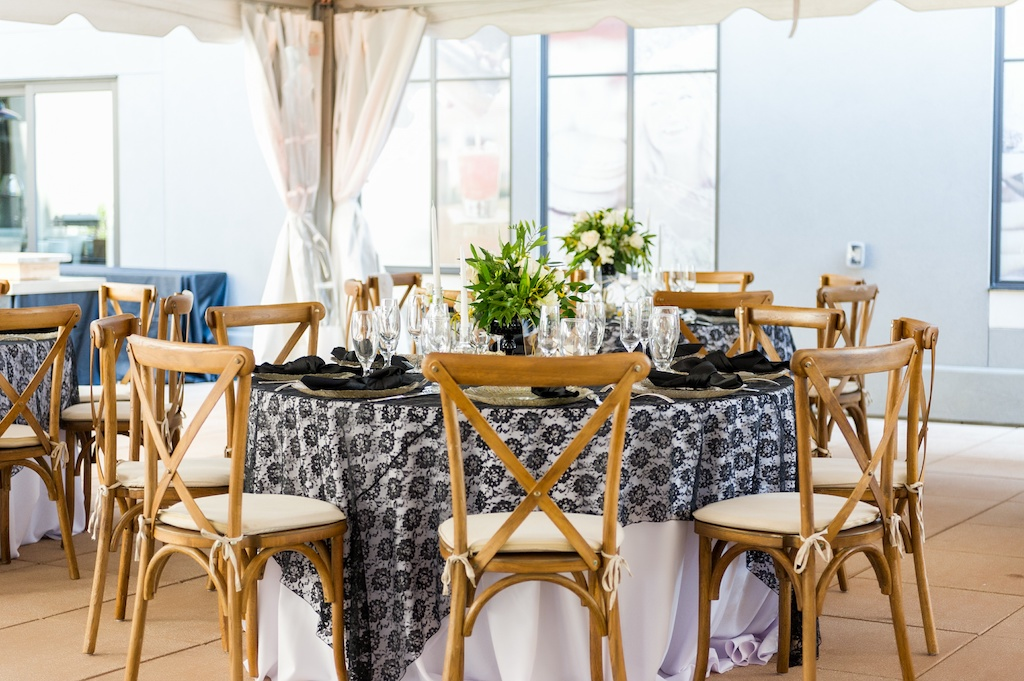 Modern, Geometric Bumble Inspired, Wedding Decor White Table Cloth with Black Lace Overlay, Wooden Chairs, Low Floral Centerpieces with Ivory Flowers and Greenery   Historic Hyde Park Wedding Venue Epicurean Hotel in South Tampa   Tampa Bay Wedding Photographer Andi Diamond Photography