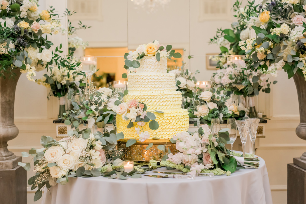 Boho Modern Chic Inspired Four Tier Yellow Ombre Ruffle Wedding Cake with White Ivory, Dusty Rose and Yellow Rose Florals with Silver Dollar Eucalyptus Greenery Floral Accents and Arrangements