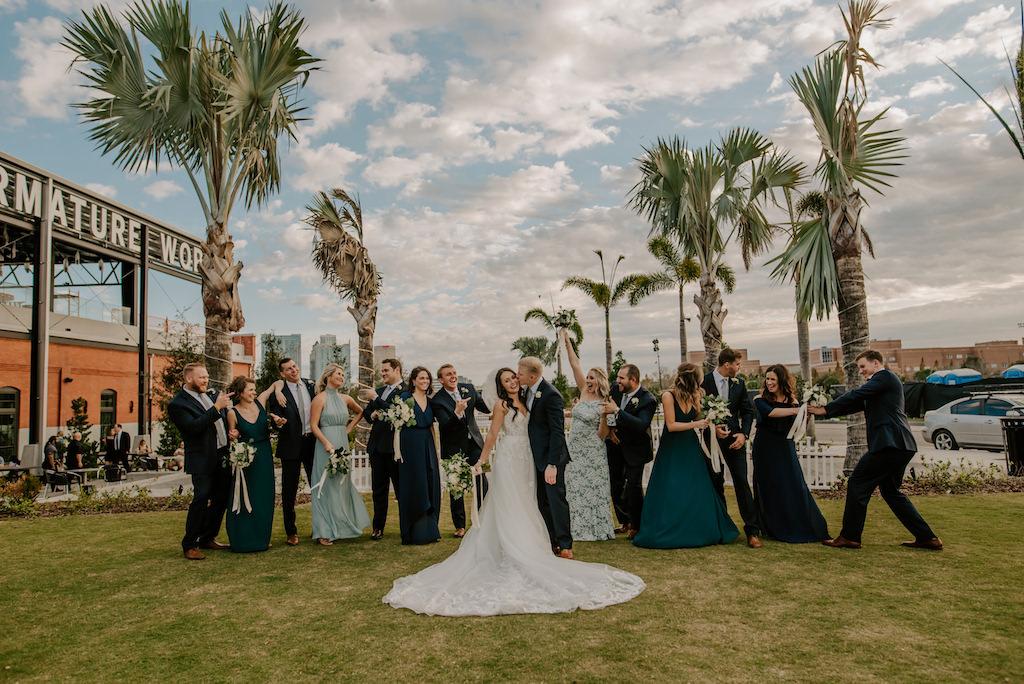Outdoor Modern, Fun, Creative Florida Bride, Groom, Bridesmaids, Groomsmen Wedding Bridal Party Portrait, Navy, Sage and Dark Green Mix and Match Bridesmaids Dresses   Tampa Bay Venue Armature Works