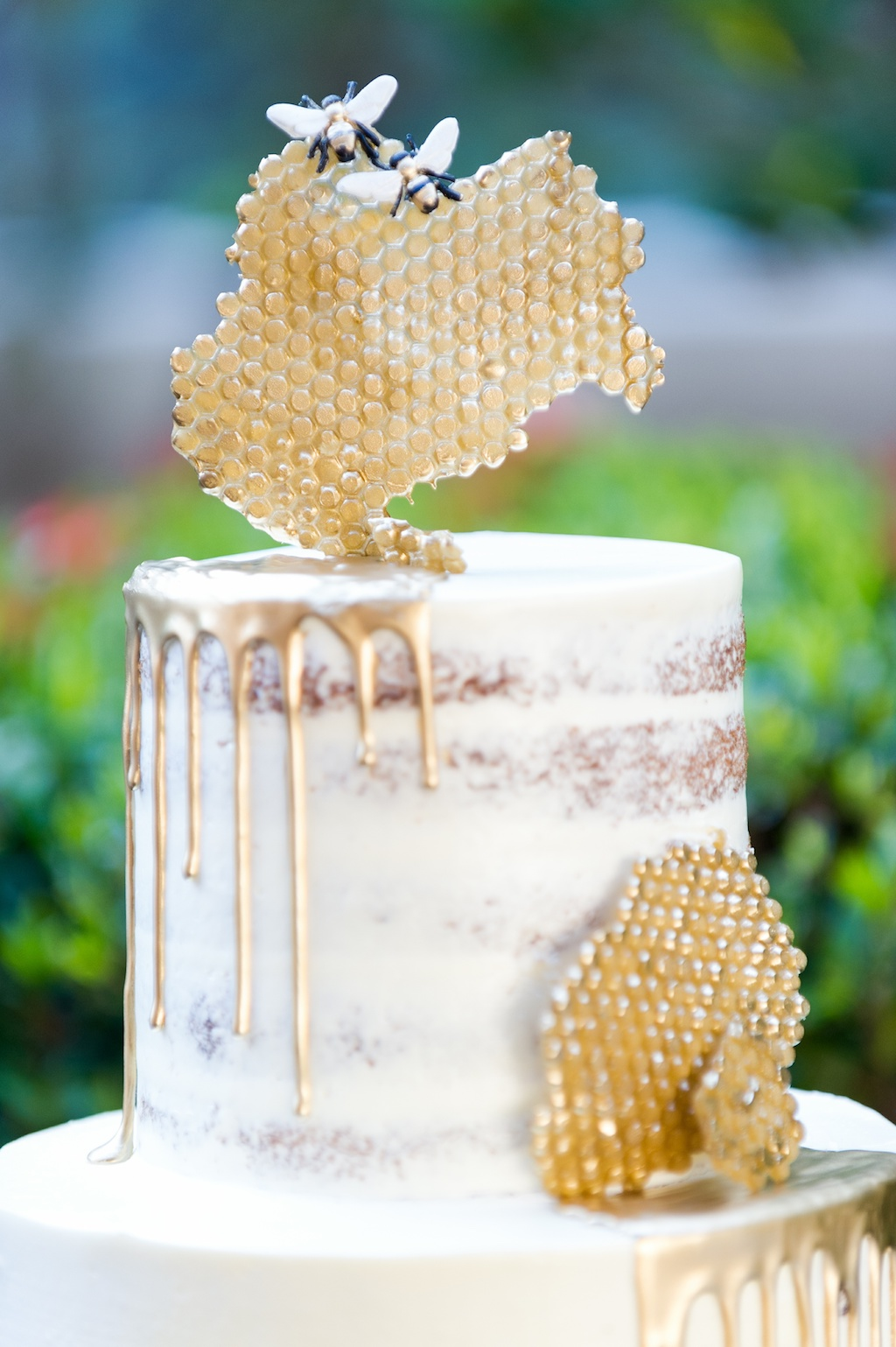 Bumble Bee Inspired, Semi Naked Wedding Cake, White Frosting, Gold Drip and Honeycomb, Bumblebees   Historic Hyde Park Wedding Venue Epicurean Hotel in South Tampa   Tampa Bay Wedding Photographer Andi Diamond Photography   Cake Decorator The Artistic Whisk
