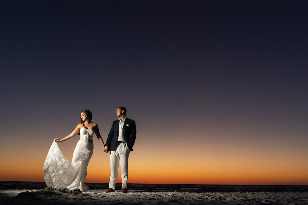 Florida Bride and Groom Sunset Wedding Portrait on Sand of St. Pete Beach Historic Don Cesar Hotel