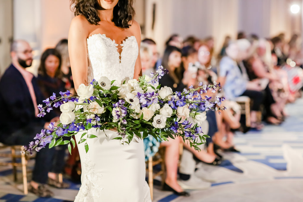 Florida Bride in Sweetheart Neckline Lace Fitted Wedding Dress, Carrying Garden Inspired, Crescent Style Wedding Bouquet, Purple Hibiscus, Ivory Carnations, White Flowers with Greenery   Planner NK Weddings   Truly Forever Bridal   The Ritz Carlton Sarasota   Tampa Bay Wedding Photographer Lifelong Photography Studios