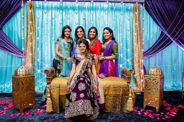Traditional Indian Bride and Bridesmaids in Colorful Mismatched Saris, Bride in Purple with Gold Accent and Extravagant Jewelry Wedding Portrait   Tampa Bay Wedding Hair and Makeup Michele Renee the Studio