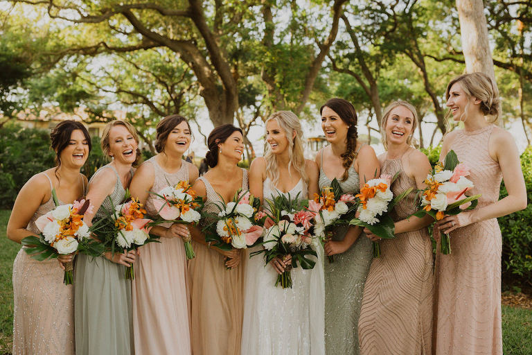 Sarasota Bride and Bridesmaids Wedding Portrait, Bride in Spaghetti Strap White Beaded Karen Willis Holmes Wedding Dress, Bridesmaids in Beige Sage and Blush Mix and Match Beaded Adrianna Papell Dresses, Carrying Tropical Wedding Bouquet with Colorful Flowers, Pink Ginger, Orchids, with Greenery