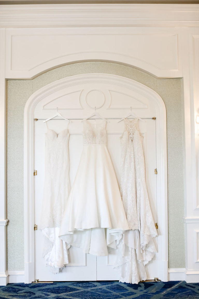 Three Hanging White Long Wedding Dresses | Truly Forever Bridal | Tampa Bay Wedding Photographer Lifelong Photography Studios