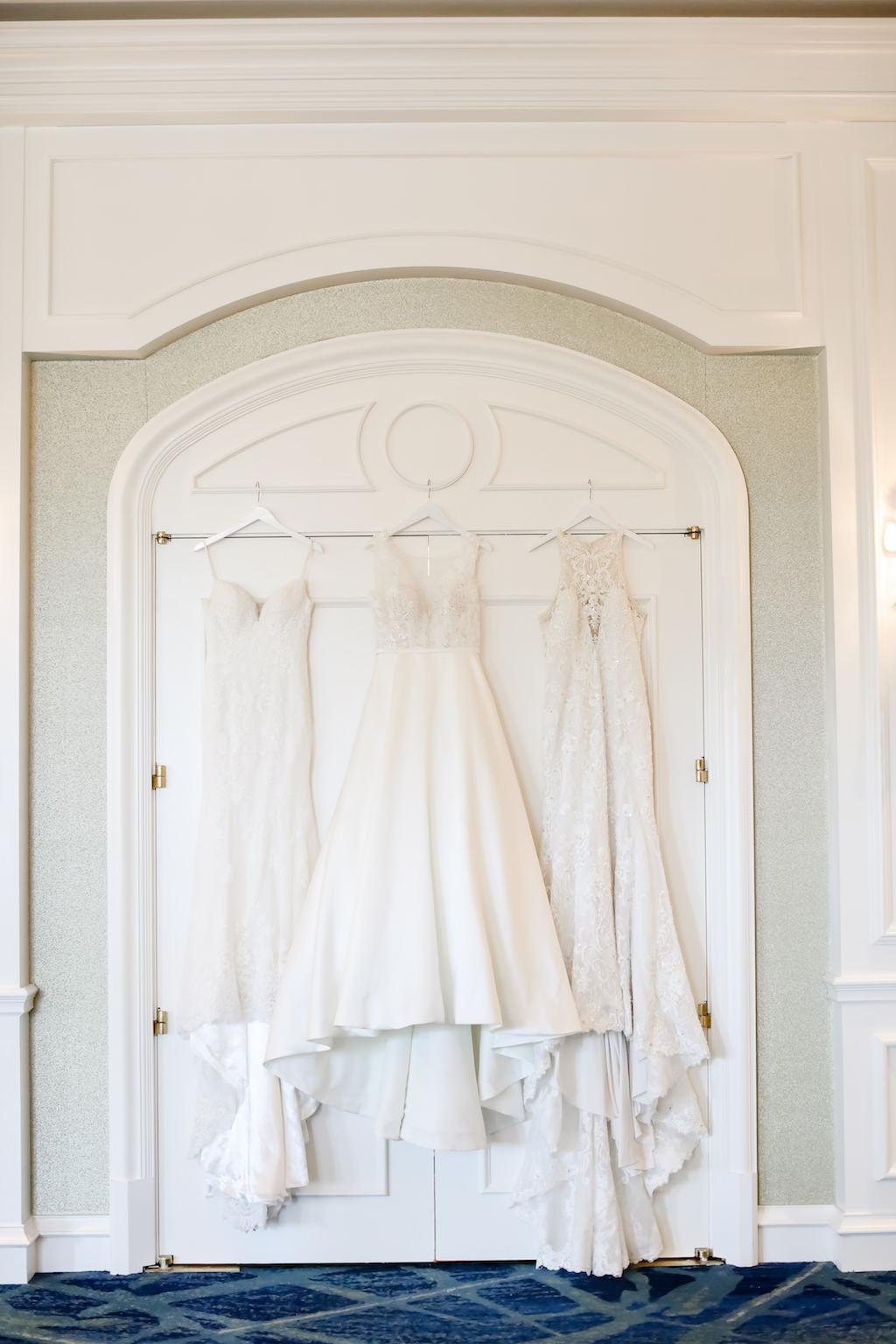Three Hanging White Long Wedding Dresses   Truly Forever Bridal   Tampa Bay Wedding Photographer Lifelong Photography Studios