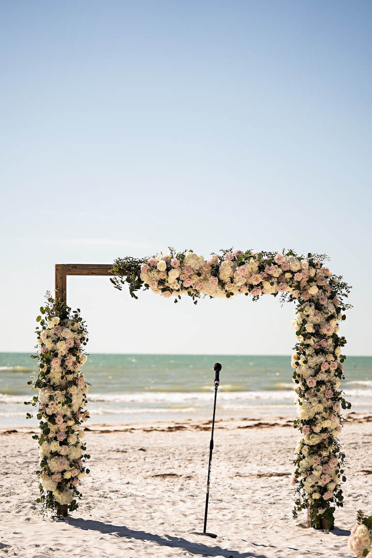 Romantic Garden Inspired Floral Square Wedding Arch at Oceanfront Ceremony on White Sand, White and Blush Pink Florals with Greenery | Tampa Bay Florist Bruce Wayne Florals | Florida Planner Parties A La Carte | St. Pete Beach Wedding Venue The Historic Don Cesar Hotel