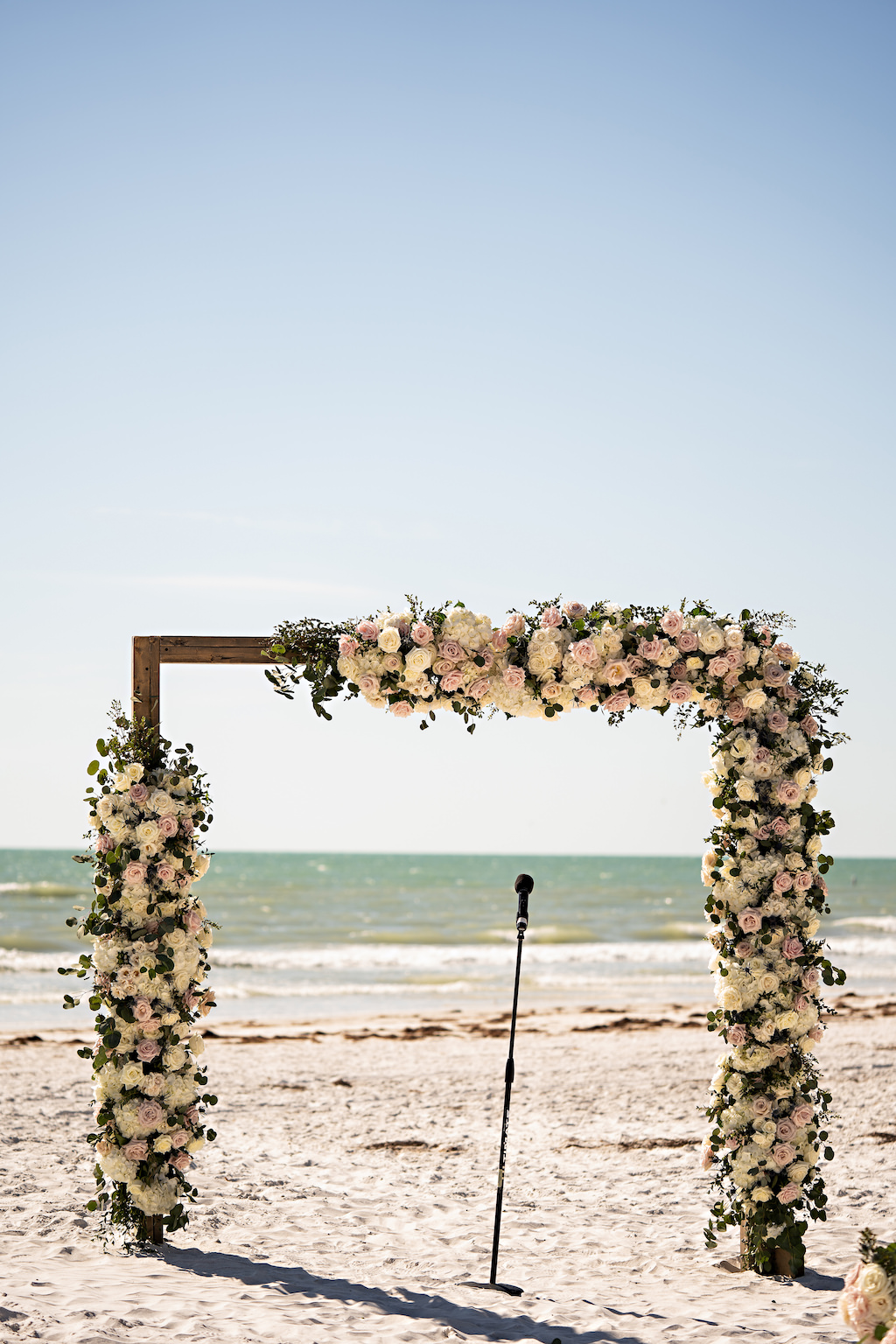 Romantic Garden Inspired Floral Square Wedding Arch at Oceanfront Ceremony on White Sand, White and Blush Pink Florals with Greenery   Tampa Bay Florist Bruce Wayne Florals   Florida Planner Parties A La Carte   St. Pete Beach Wedding Venue The Historic Don Cesar Hotel