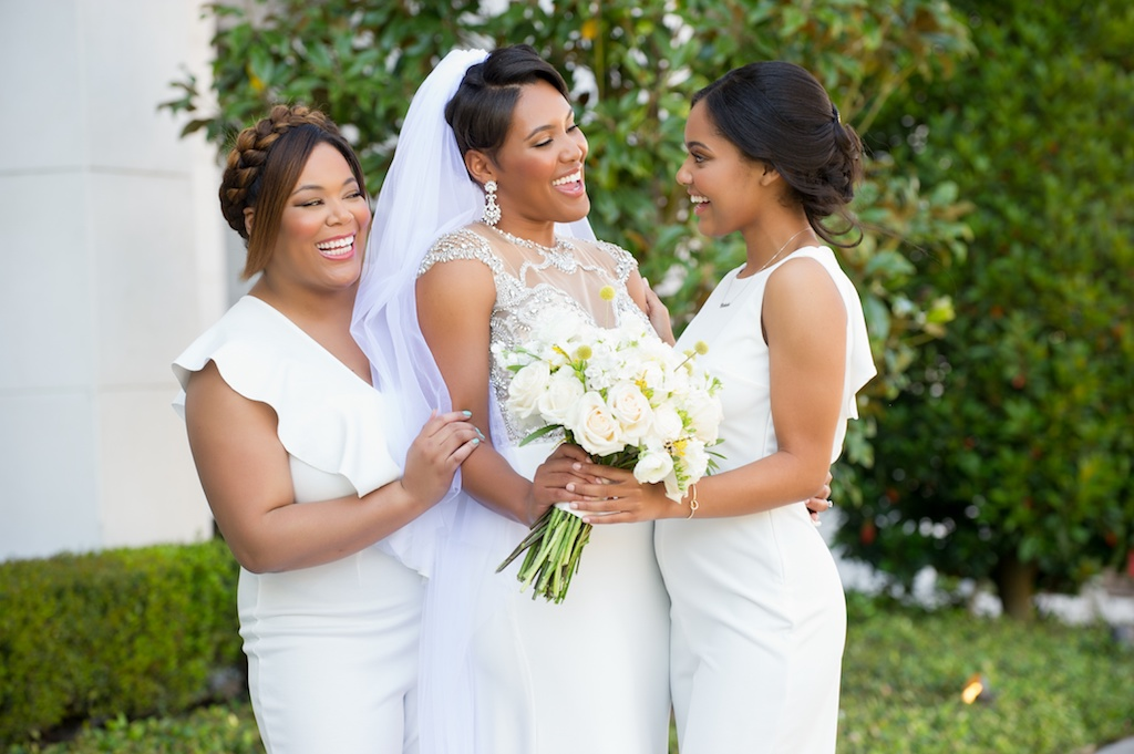 Elegant Florida Bride and Bridesmaids Portrait, Holding Blush Pink, and Ivory Floral Wedding Bouquet, Yellow Bumble Inspired Flowers, Bridesmaids in Modern White Jumpsuits, Historic Hyde Park in South Tampa   Tampa Bay Wedding Photographer Andi Diamond Photography