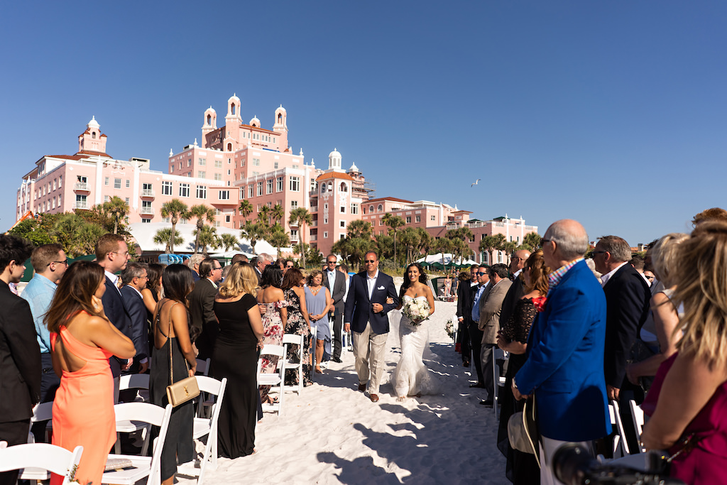 Tampa Bay Bride Walks Down Aisle During Ceremony Processional on White Sand Beach   Florida Wedding Planner Parties A La Carte   St. Pete Beach Venue The Historic Don Cesar Hotel