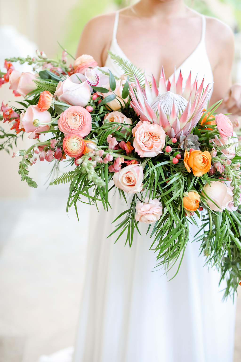 Tropical Inspired, Garden Crescent Style Wedding Bouquet with Pink King Protea, Peach, White and Orange Florals with Greenery  Tampa Bay Wedding Photographer Lifelong Photography Studios