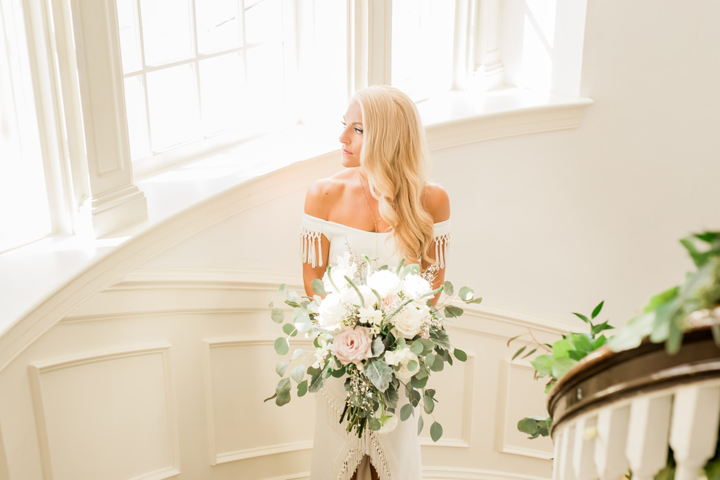 Tampa Bay Bride Wedding Portrait on Staircase Holding Organic Garden White Ivory Blush Pink Floral and Greenery Bouquet | South Tampa Hair and Makeup Artist LDM Beauty Group