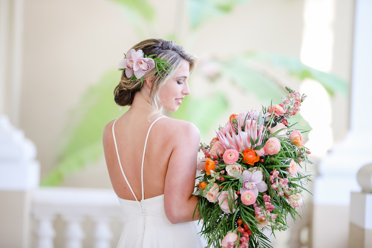 Boho Bride, Carrying Tropical Inspired, Garden Crescent Style Wedding Bouquet with Pink King Protea, Peach, White and Orange Florals with Greenery| Tampa Bay Wedding Photographer Lifelong Photography Studios | Truly Forever Bridal Shop Sarasota