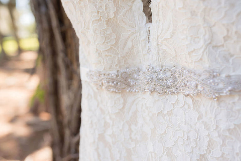 Mikaella Lace Wedding Dress with Plunging V Neckline and Capsleeves and Rhinestone Crystal Belt | Tampa Bay Kristen Marie Photography