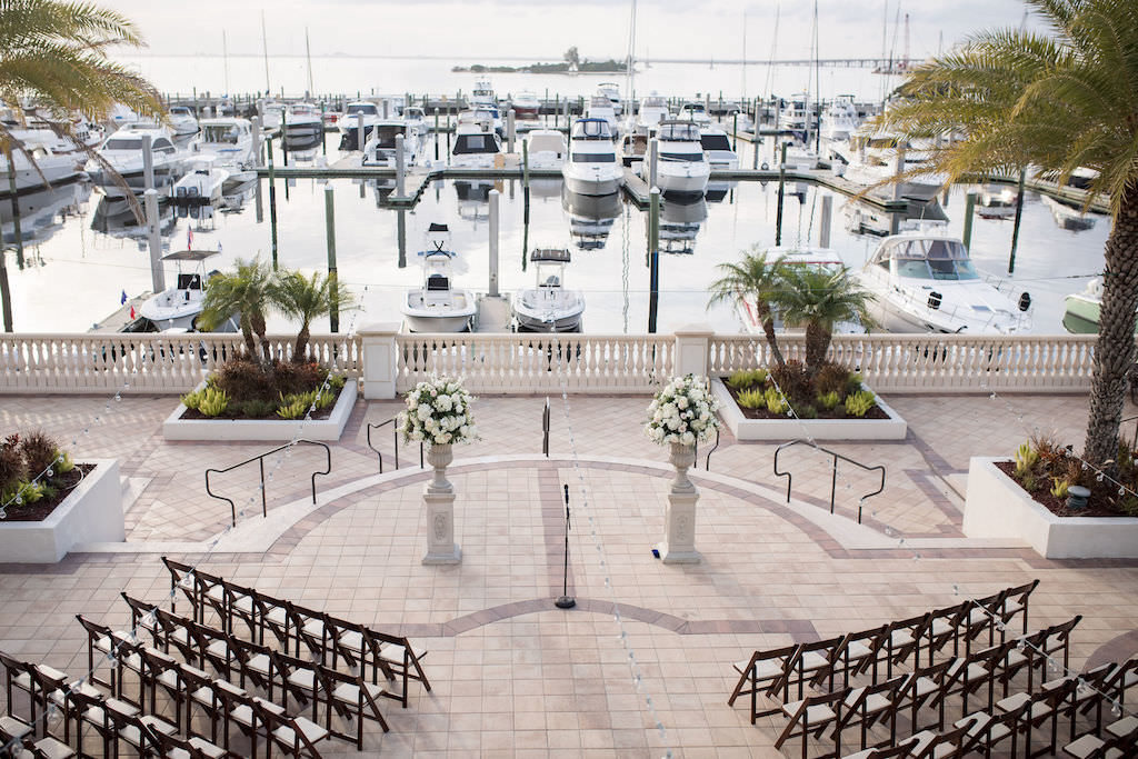 Outdoor Waterfront Classic Elegant Wedding Ceremony Decor, Tall Pedestals with White Floral Bouquets   Tampa Bay Wedding Venue Westshore Yacht Club   South Tampa Luxury Wedding Planner NK Productions Wedding Planning