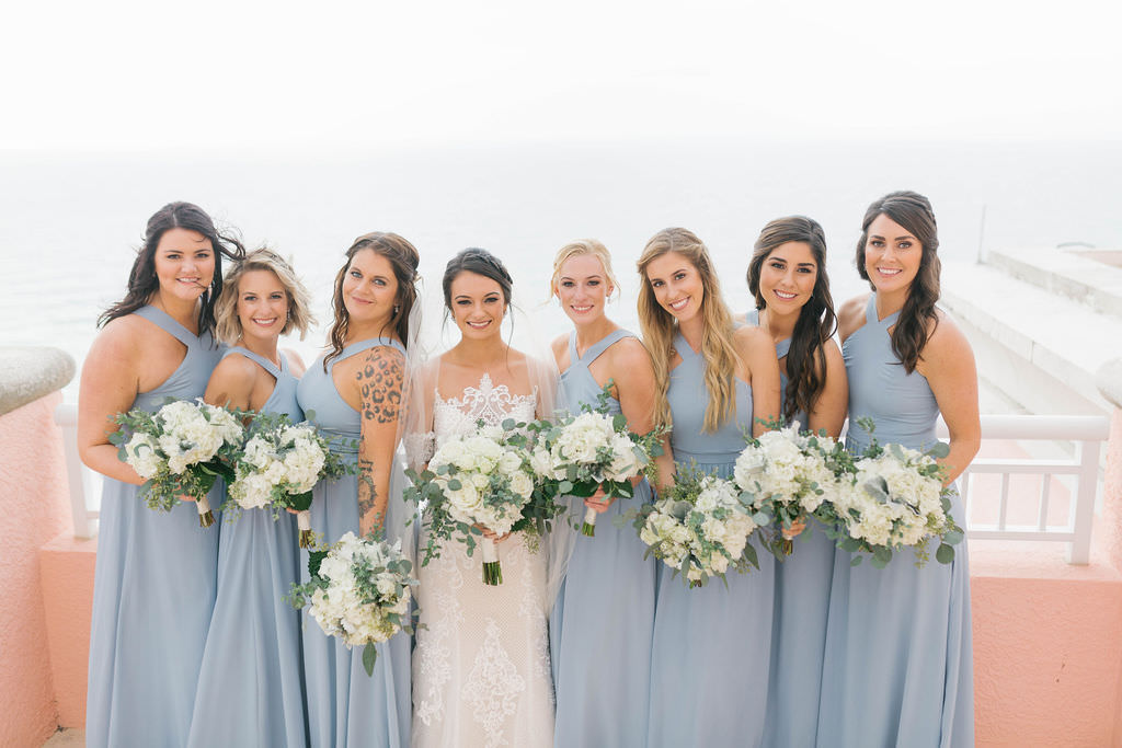 Tampa Bay Bride and Bridesmaids Wedding Portrait, Bridesmaids in Dusty Blue Cross Halter Top Long Dresses with White and Greenery Floral Bouquets by Bruce Wayne Florals   Waterfront Hotel Wedding Venue Hyatt Regency Clearwater Beach