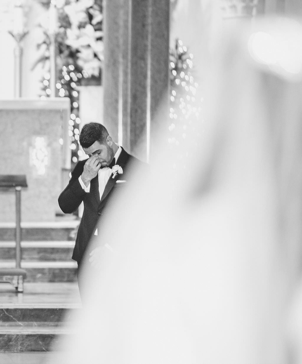 Groom's Emotional Reaction to Watching Bride Walking Down the Church Ceremony Aisle