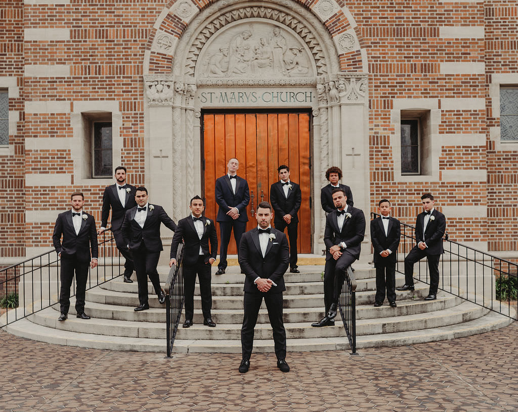 Tampa Bay Groom and Groomsmen Wedding Party Portrait Outside Traditional Wedding Ceremony Venue St. Mary's Catholic Church