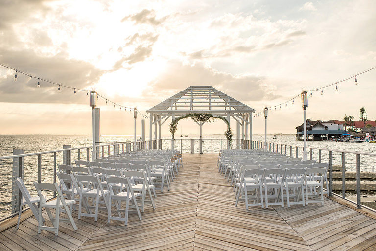 Sunset Waterfront Dockside Wedding Ceremony Under Cabana, Nautical Inspired Decor, Green Floral Arch | | Tampa Bay Hotel and Wedding Venue The Godfrey Hotel & Cabanas