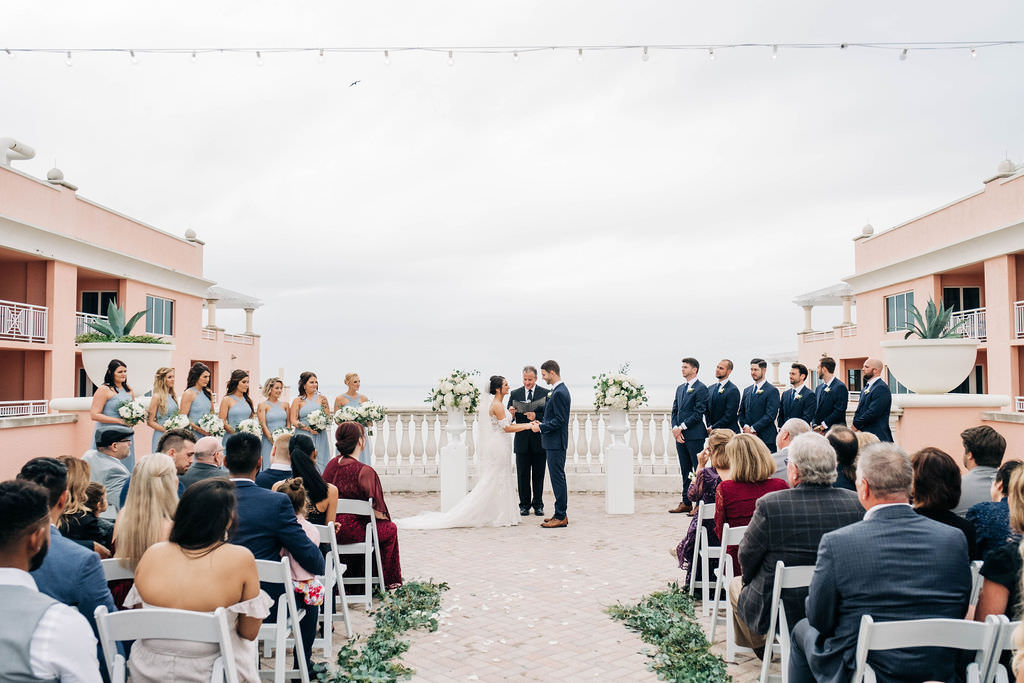 Tampa Bay Bride and Groom Exchanging Vows Wedding Ceremony Portrait   Waterfront Hotel Wedding Venue Hyatt Regency Clearwater Beach   Planner Parties A'la Carte