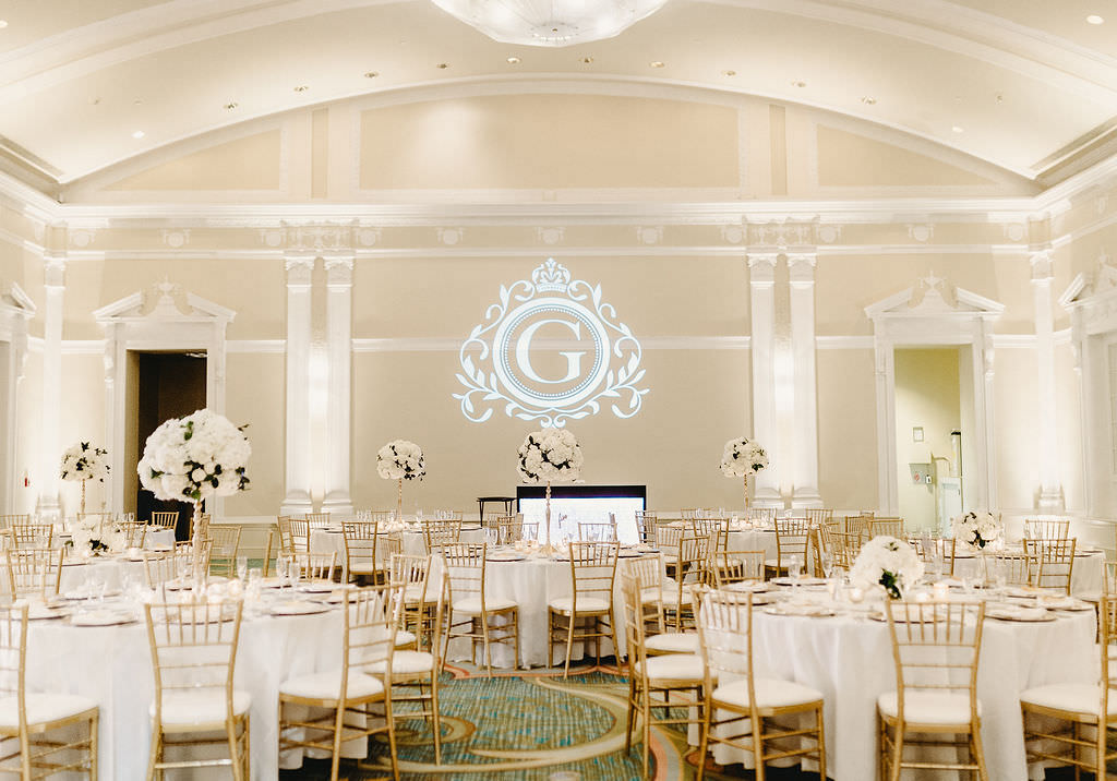 Classic Traditional Ballroom Wedding Reception Decor, Round Tables with Tall White Floral Centerpieces and Gold Chiavari Chairs, Custom Monogram Gobo Logo Projection   Downtown St. Pete Hotel Wedding Venue The Vinoy Renaissance