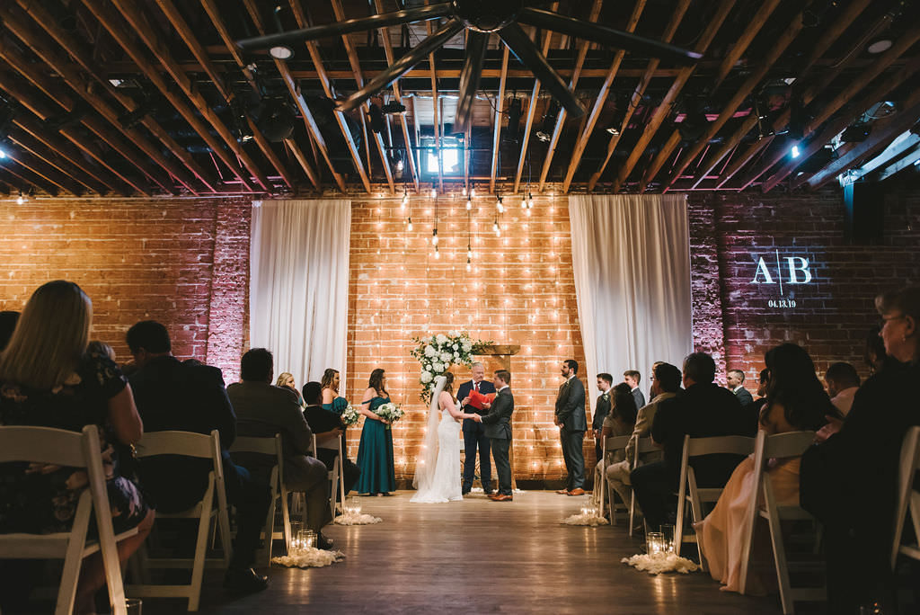 Florida Bride and Groom Exchanging Vows, Modern, Industrial Indoor Wedding Ceremony, String Light and Red Brick Backdrop| Downtown St. Pete Venue NOVA 535 | Tampa Bay Photographer Kera Photography