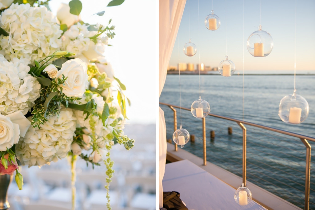 White Jewish Wedding Ceremony with Greenery and White Flowers and Hanging Candles | Clearwater Beach Waterfront Wedding Venue Opal Sands