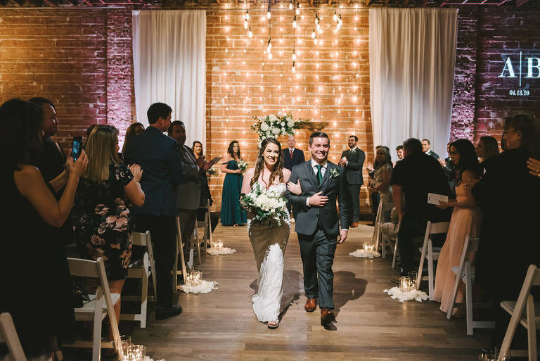 Florida Bride and Groom, Modern, Rustic Industrial Indoor Wedding Ceremony, Just Married, Recessional, White and Greenery Decor | Downtown St. Pete Venue NOVA 535 | Tampa Bay Photographer Kera Photography