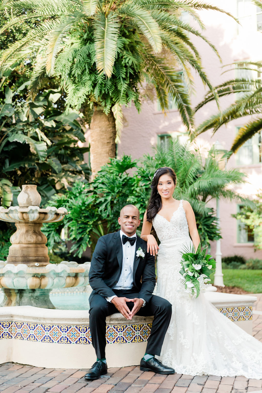 Modern Bride and Groom Wedding Portrait in Downtown St. Pete Resort in the Tea Garden at The Vinoy Renaissance Resort & Golf Club | White and Green Floral Bridal Bouquet by Tampa Bay Florist Bruce Wayne Florals