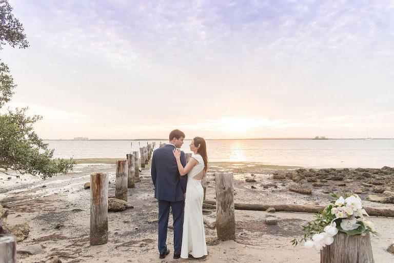 Dunedin Florida Outdoor Beach Sunset Bride and Groom Wedding Portrait | Tampa Bay Wedding Photographer Kristen Marie Photography