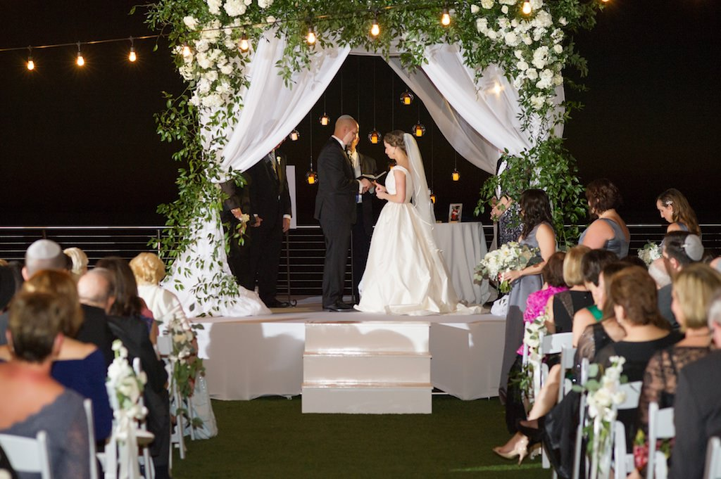 White Draped Jewish Wedding Ceremony Chuppah with Greenery and White Flowers | Clearwater Beach Waterfront Wedding Venue Opal Sands