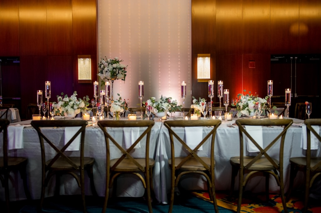 Elegant, Romantic Ballroom Wedding Reception with Long Feasting Tables, Low White Centerpieces, Candles and French Country Chairs