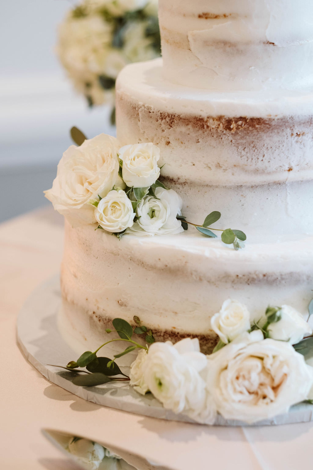 Semi Naked Wedding Cake Garnished with Real Ivory, White Rose Florals