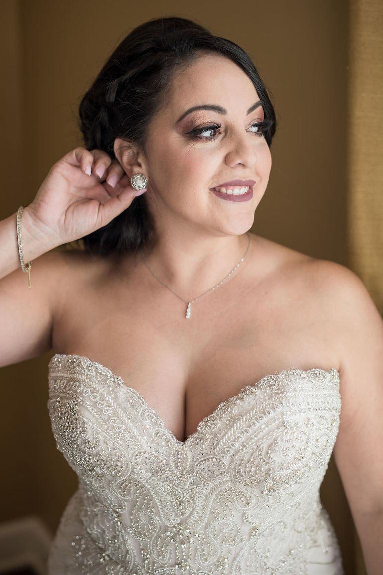 Florida Bride Getting Ready Wedding Portrait in Strapless Sweetheart Rhinestone Bodice Essense of Australia Wedding Dress