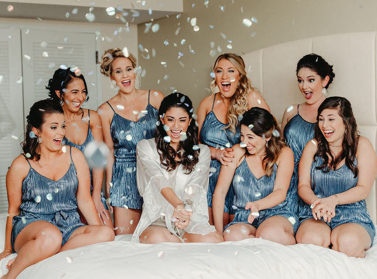Bride and Bridesmaids Getting Ready Confetti Wedding Portrait in Matching Blue Pajama Rompers